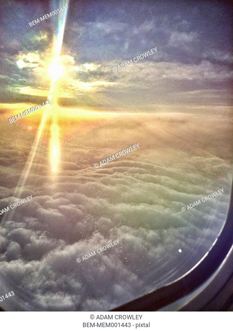 Sunrise over clouds viewed from airplane window