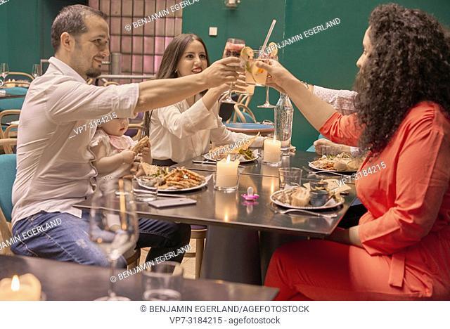 Family eating in restaurant, Vegan Oriental, Kismet, in Munich, Germany