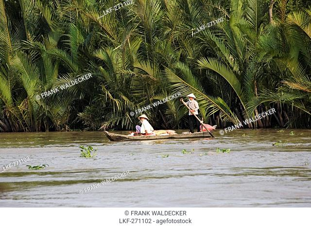 Vietnamese women on a boat on the Mekong River, Mekong Delta, Can Tho Province, Vietnam, Asia