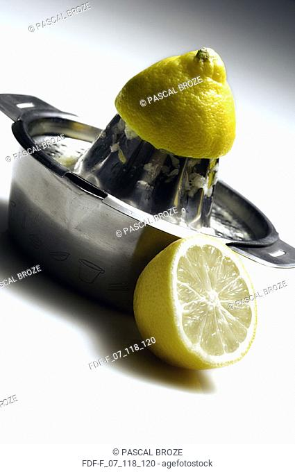 Close-up of a juicer with two lemons cut in half