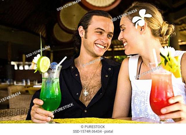 Close-up of a couple enjoying cocktail, Papeete, Tahiti, French Polynesia