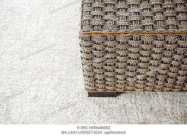 Wicker ottoman on carpet