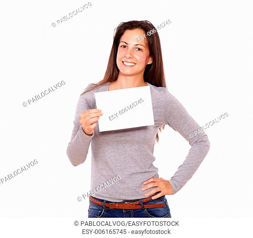 Portrait of a beautiful female holding card smiling at you - copyspace