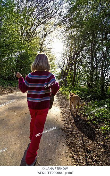 Little girl walking the dog