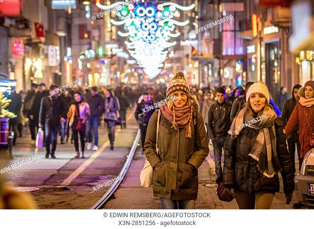 Tourists and locals walk through Taksim square, located in Istanbul, Turkey