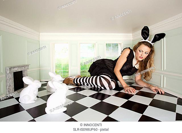Young woman trapped with rabbits in small room