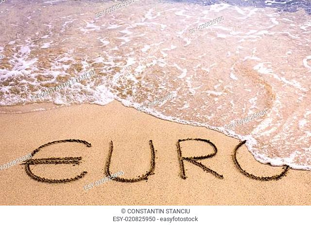 euro word written in the sand on a beach