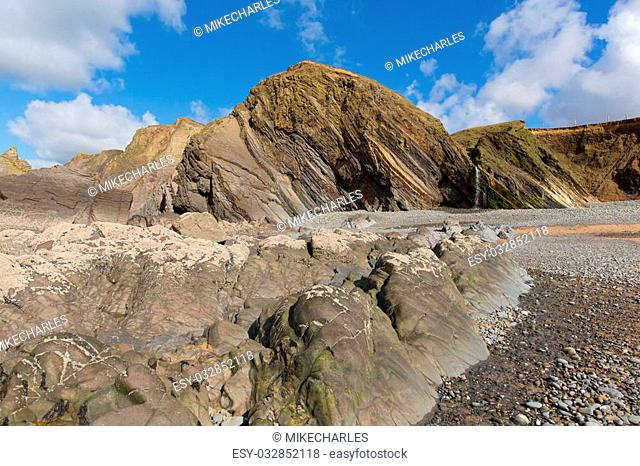 Sandymouth beach North Cornwall England UK with unusual beautiful rock formations and waterfall