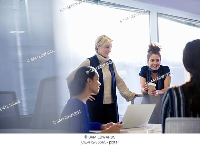 Businesswomen talking, working in conference room meeting