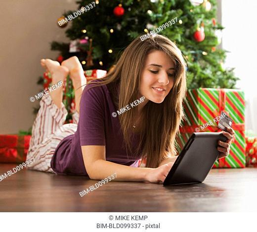 Caucasian woman using digital tablet at Christmas time