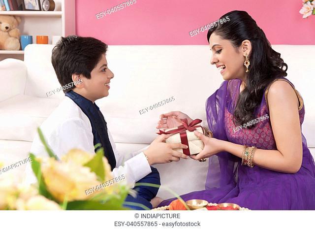 Brother giving gift to his sister at Raksha Bandhan