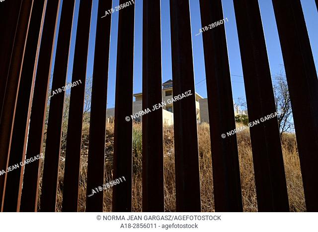 A U.S. Border Patrol agent indicated that the house in Nogales, Sonora, Mexico, seen through the border wall from Nogales, Arizona, USA