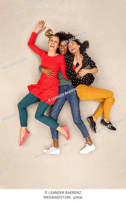 Three girl friends having fun