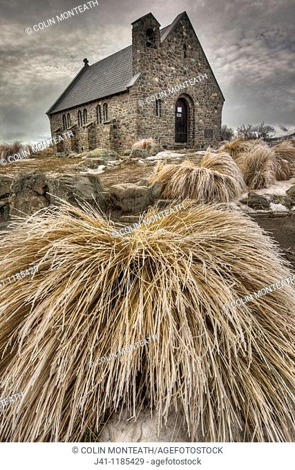 Church of the Good Shepherd, frosted tussock grass in winter, Lake Tekapo, Canterbury, New Zealand