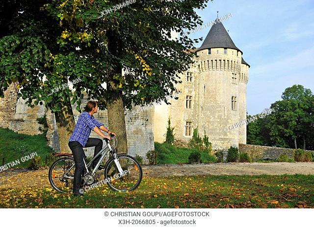 young woman cycling in front of the Castle St-Jean, Nogent-le-Rotrou, Parc naturel regional du Perche, Eure & Loir department, region Centre, France, Europe