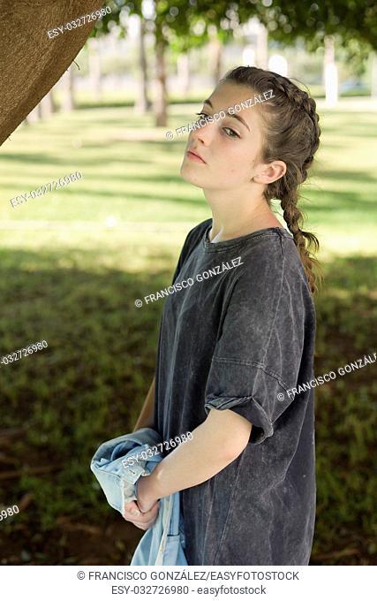 Girl in gray dress in the gardens of the University of Alicante, Spain