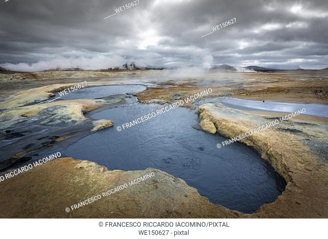 Hverir, geothermal area in Northern Iceland, with steam and mud pools. tourists enjoying the view