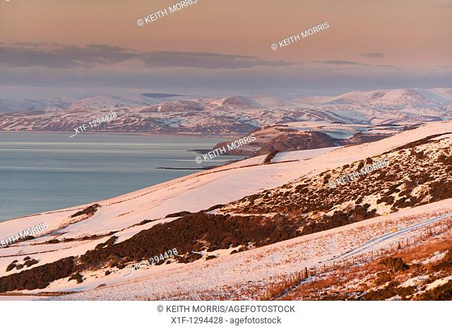 Looking towards Aberystwyth and Aberdyfi Wales UK, in the snow, Christmas Day, 2010 - with mountains of Snowdonia in distance