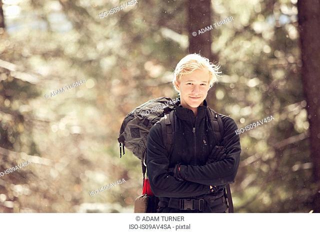 Portrait of young male hiker in sunlit forest, Ashland, Oregon, USA