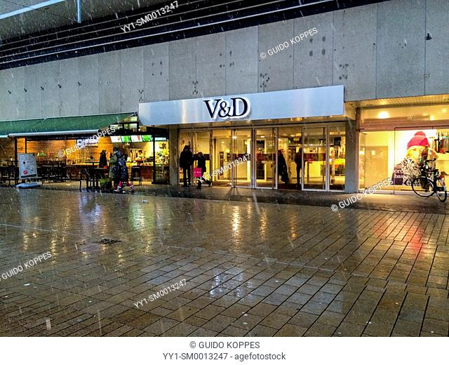 Tilburg, Netherlands. Facade of warehouse 'Vroom & Dreesman' V&D in Tilburg's main street during a rainy winter afternoon