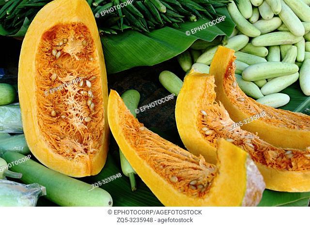 Pumpkin slices with cucumber at vegetable market Pune, Maharashtra