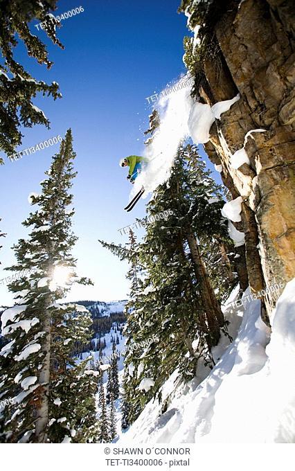 Skier jumping off cliff Aspen Snowmass, Aspen, Colorado, USA