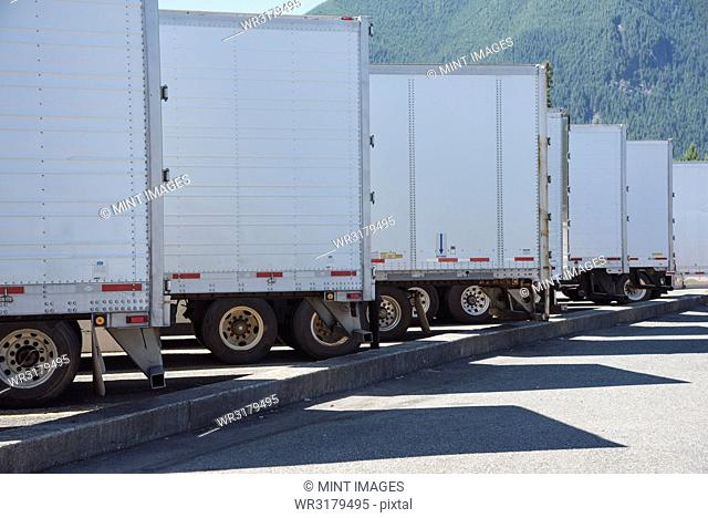 Trailers lined up in a truck stop parking lot