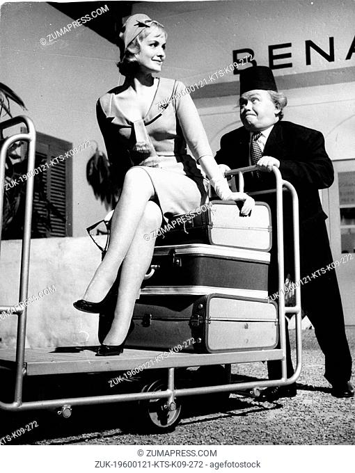 Jan. 21, 1960 - London, England, U.K. - Comedian CHARLIE DRAKE and actress/model SARAH BRANCH in a scene from the film 'Sands of The Desert' in which they...