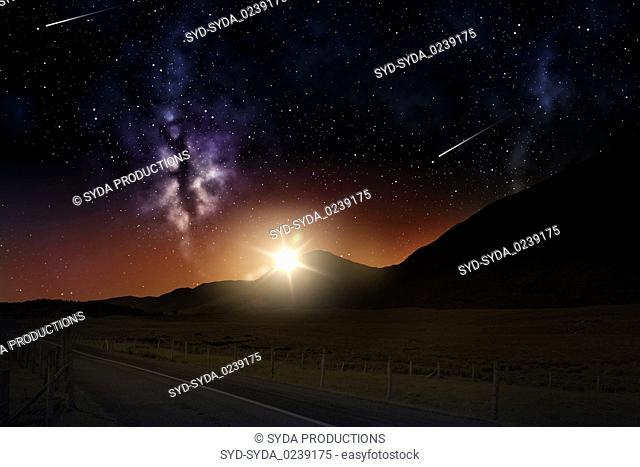 landscape over sunrise in night sky or space