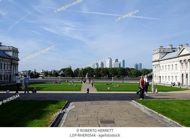 England, London, Greenwich, Old Royal Naval College in Greenwich with Canary Wharf office towers in the distance