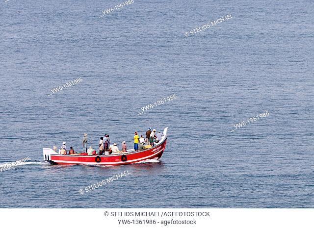 Red fishing boat off the coast of Varkala,Kerala,India