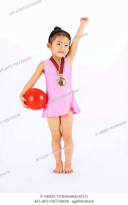 Gymnast girl with medal