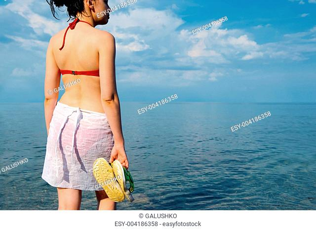 The girl in a bathing suit against the sea