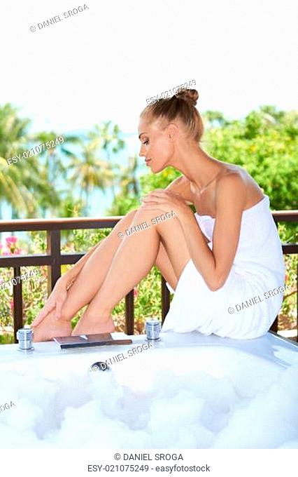 Attractive female wrapped in white towel