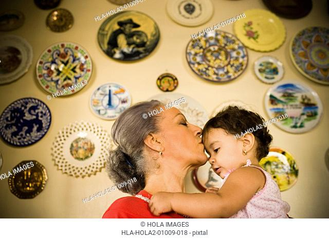 Mature woman holding her granddaughter