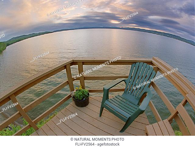 Deck chair on deck overlooking Francois Lake, BC