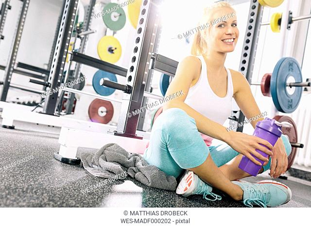 Young woman relaxing after training at gym