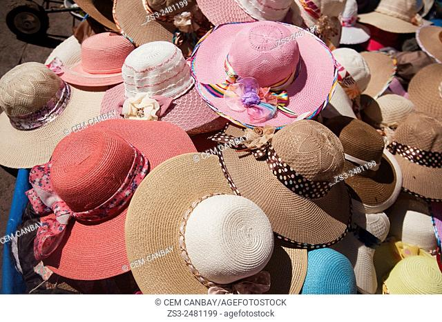 Colorful hats for sale at the street market, Cuzco, Peru, South America