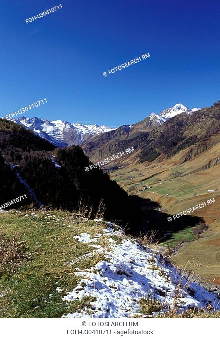 France, Col du Tourmalet, Midi-Pyrenees, The Pyrenees, Hautes-Pyrenees, Europe, Scenic view of the snow capped Pyrenees Mountains and the valley below of Col du...