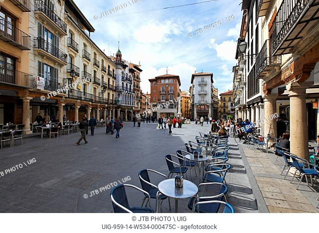 Europe, Spain, Aragon, Teruel, View of houses and pavement café. (Photo by: JTB Photo/UIG via Getty Images)