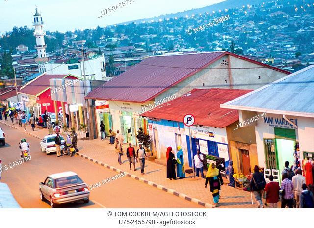 Aerial view of main street - KN 2 Avenue - at dusk, with hillside suburbs beyond, Nyamirambo, Kigali, Rwanda