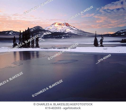 Sunrise on South Sister from Sparks Lake after fall snowstorm. Deschutes National Forest, Deschutes County. Central Oregon. USA
