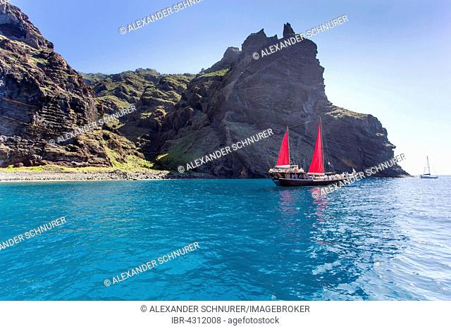 Sailing ship with red sails in a small bay near Los Gigantes, Santiago del Teide, Tenerife, Canary Islands, Spain