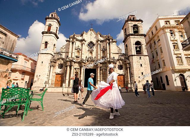 Santeria woman dancing in front of Cathedral of San Cristobal, Havana Vieja, Old Havana District, Havana, Cuba, West Indies, Central America