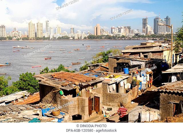 Hutments at Worli village and background city skyline of Bombay Mumbai; Maharashtra; India