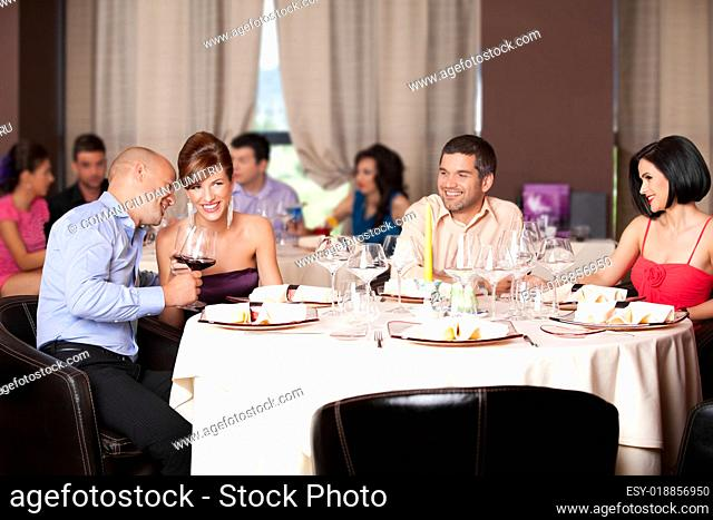 young people flirting restaurant table