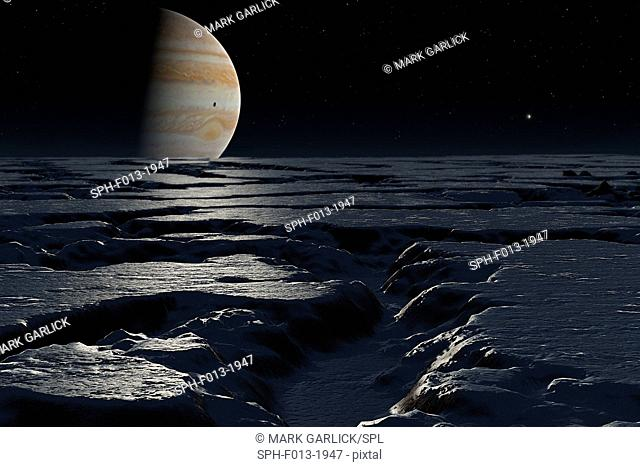 Jupiter over Europa. The planet Jupiter seen above the horizon of the icy landscape of Europa. Jupiter is shown with a shadow on it cast by it innermost moon