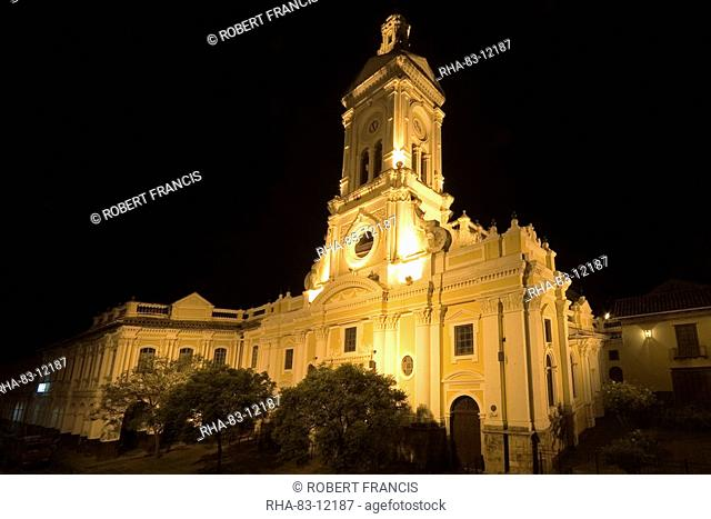 The 19th century Church of San Francisco illuminated at night on Plaza San Francisco in this attractive colonial capital, Cuenca, Azuay Province