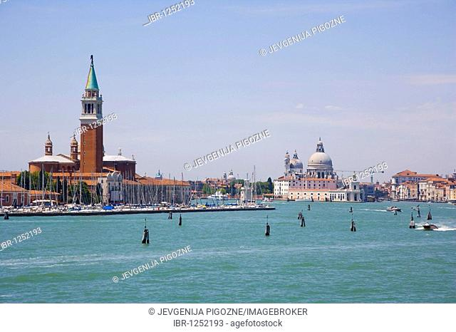 View of Venice from Canale di San Marco with the spire of Church of San Giorgio Maggiore and the domes of Church of Santa Maria della Salute, Venice, Italy