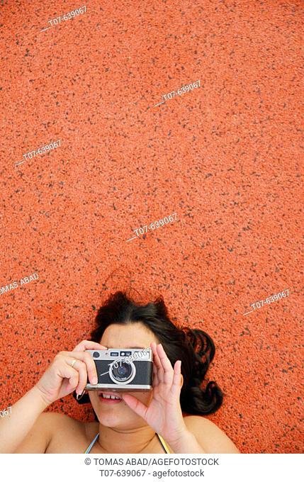 Latino Woman holding a camera
